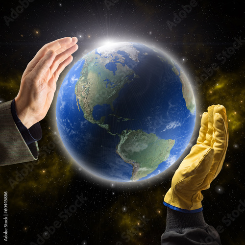 Hands of businessman and worker holding Planet Earth