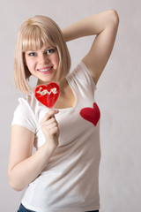 girl on Valentine's Day in jeans on a white background
