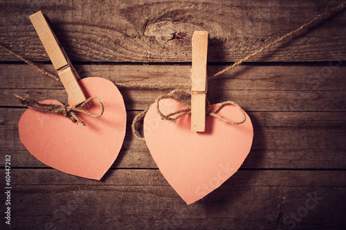 vintage pink herts on wooden background