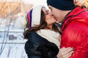 fashion portrait of young  couple in cold winter wather.
