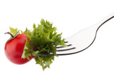 Fresh salad and cherry tomato on fork isolated on white backgrou