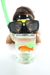 Woman watching a fish with goggles with holiday desire of diving