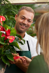 Florist is consulting a customer