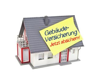 Haus mit Zettel und Gebäudevrsicherung