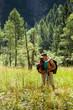 Couple is doing trekking in the woods