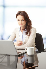 Beautiful businesswoman working on her laptop