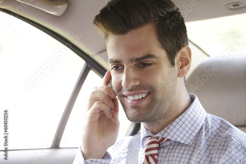 Businessman working in car