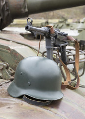 German Schmeisser submachine gun and helmet on the armor of the