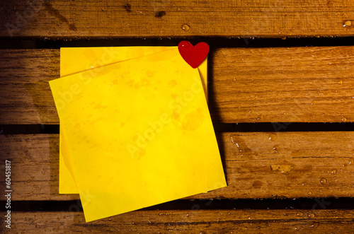 Yellow blank paper with little red heart