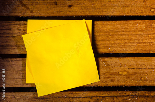 yellow blank paper on wood pettern background