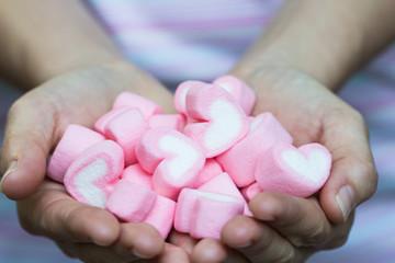 marshmallows hand in