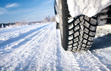 Fototapety Closeup of car tires in winter morning