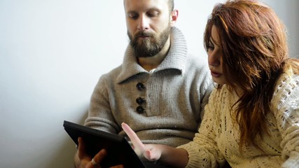 couple working home using tablet