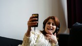 beautiful iranian red hair woman selfie and listening to music  poster