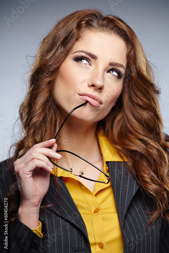 business woman with glasses on grey background