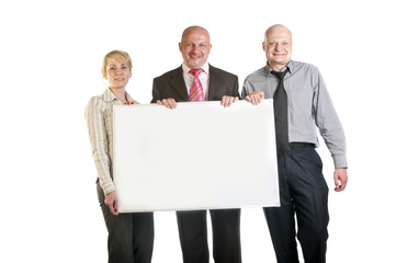 Three business people holding a banner