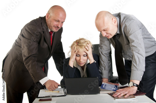 Three business people working at meeting