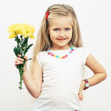 Smiling Girl hold yellow flowers.