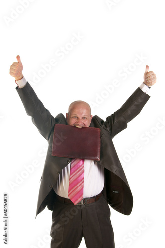 Happy businessman holding thumbs up
