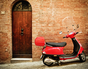Vintage image of red scooter on the street