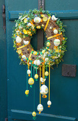 Easter decorations on the doors of old houses