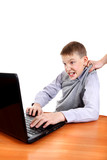 Parent dragging Son from Laptop