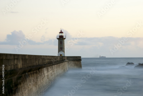Long exposure of light house in twilight - 60459426