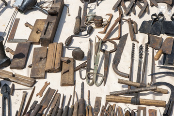 Various rusted vintage metal tools