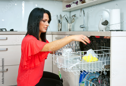 attractive woman using dishwasher