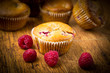 Raspberry muffins on wooden background