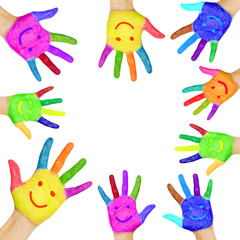 human hands painted in colorful paint with smiles.