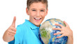 Smiling boy in casual  holding planet earth with thumbs up
