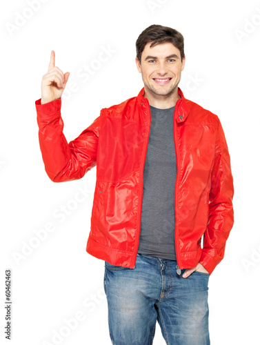 Young smiling man points with finger up