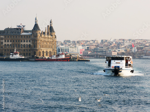 A boat in Bosporus on the background of Haydarpasa train station