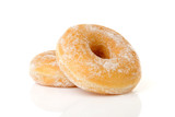 Two stacked sugared donuts over white background