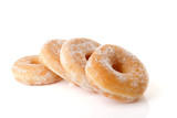 Four stacked sugared donuts over white background