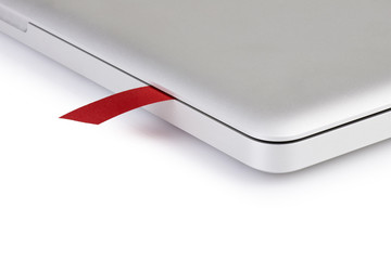close-up on a red ribbon in a laptop