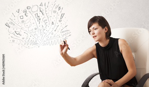 Young girl drawing and skteching abstract lines