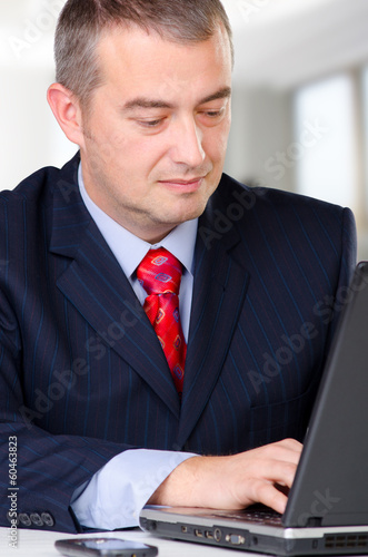 Businessman working on the notebook