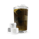 Soda in glass with ice cubes isolated on white
