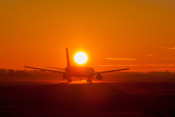 Plane take off during sunset