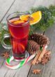 Christmas mulled wine with spices and snowy fir tree