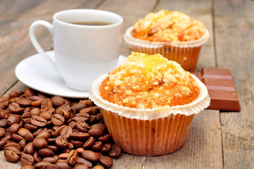 cup of coffee with muffin and chocolate