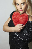 Beautiful Blond Woman with Red Heart.Show Love Symbol