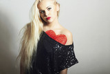 Beautiful Blond Woman with Red Heart.Valentine's Day.Under Dress