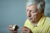 Elderly man with medicines