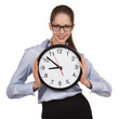 Woman in glasses holding big clock
