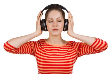 Girl, eyes closed, listening to music