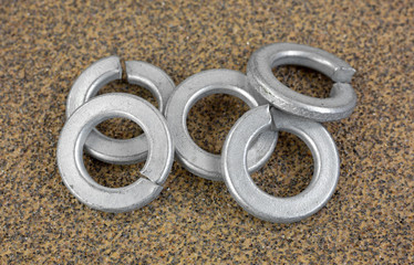 Steel lock washers on sandpaper