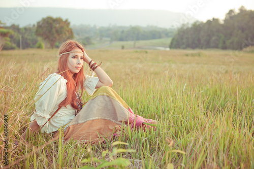 Hippie girl at golden field